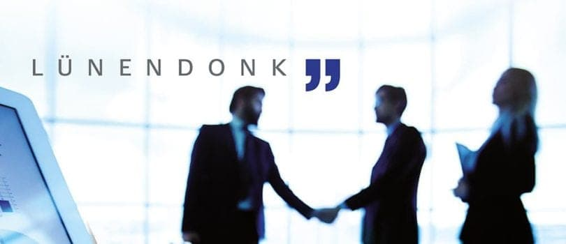 luenendonk text in front of 2 men shaking Hands